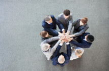 Business people stacking hands in circle