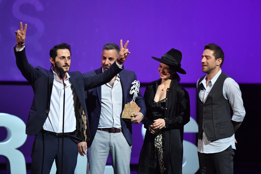 The team from Israel's When Heroes Fly after winning the CANNESERIES award for Best Series